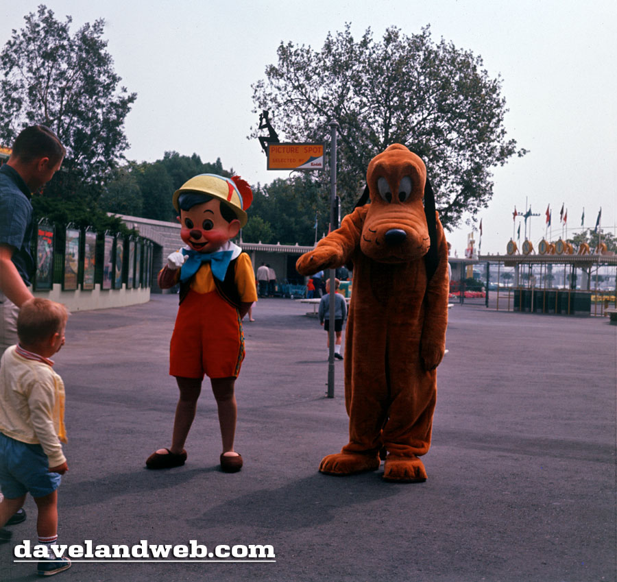 Pinocchio and Pluto are on Pinocchio Donkey Costume