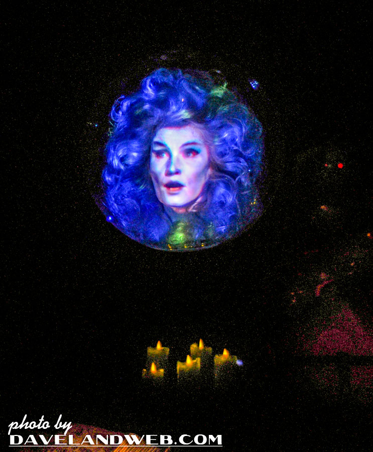 I have mixed feelings about the addition of the floating effect for Madame  Leota. Even though it is dark, the wires are still visible.